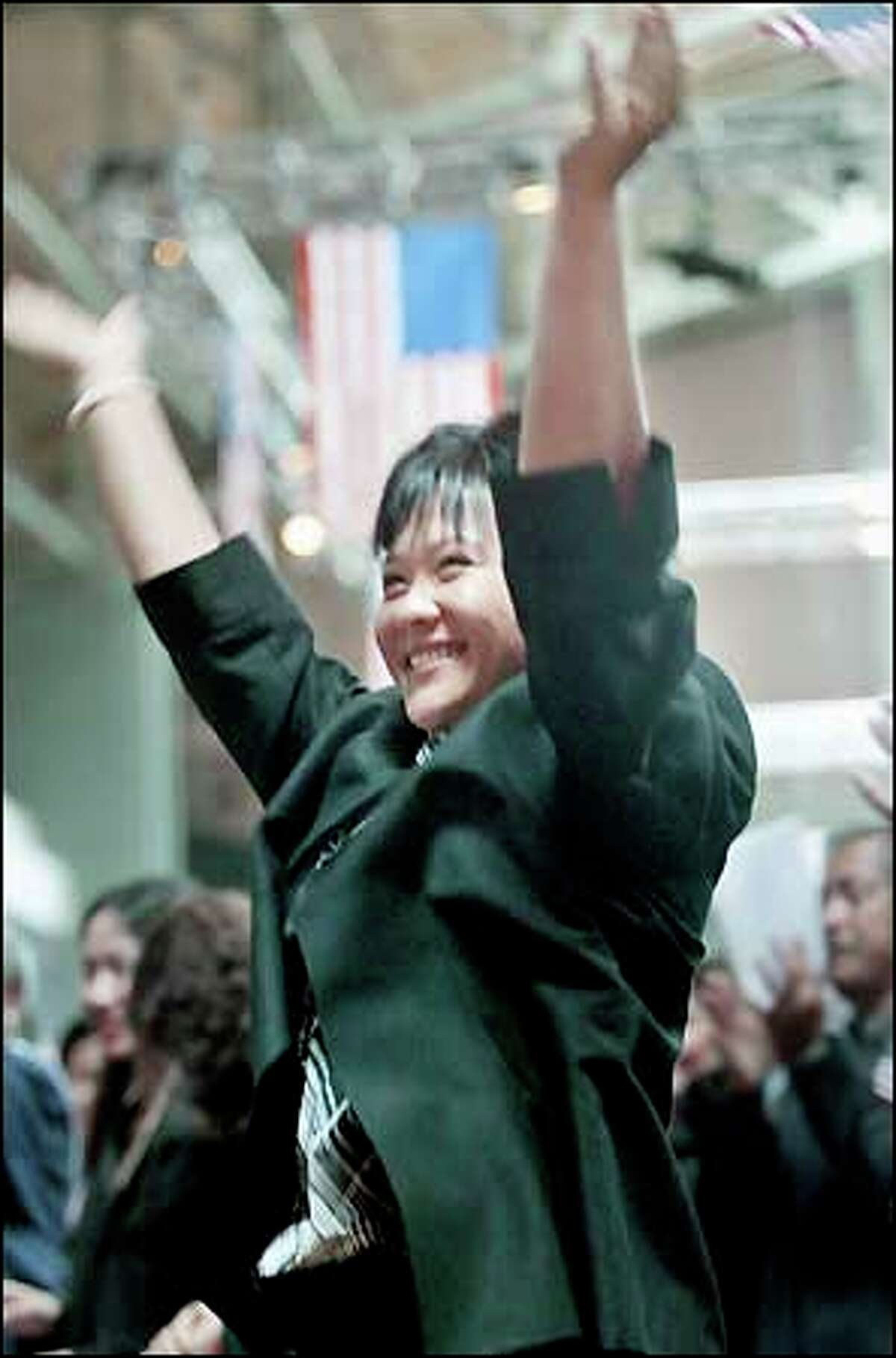 Ying Shen Winkle of Taiwan jumps for joy after being sworn in as a new citizen yesterday. Immigrants from 65 countries became Americans.