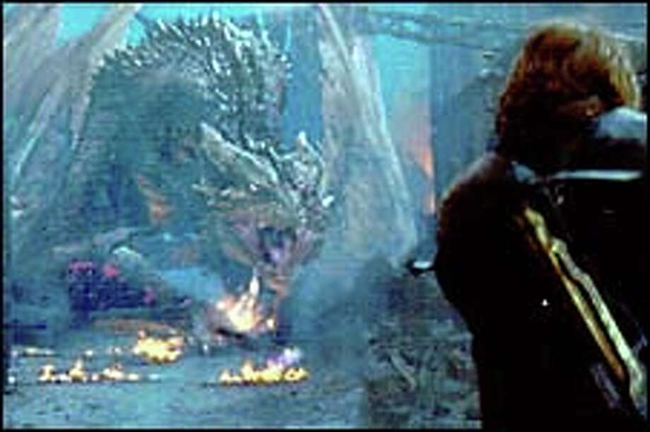 Fire-breathing dragons face off against well-armed humans in 'Reign of Fire.'