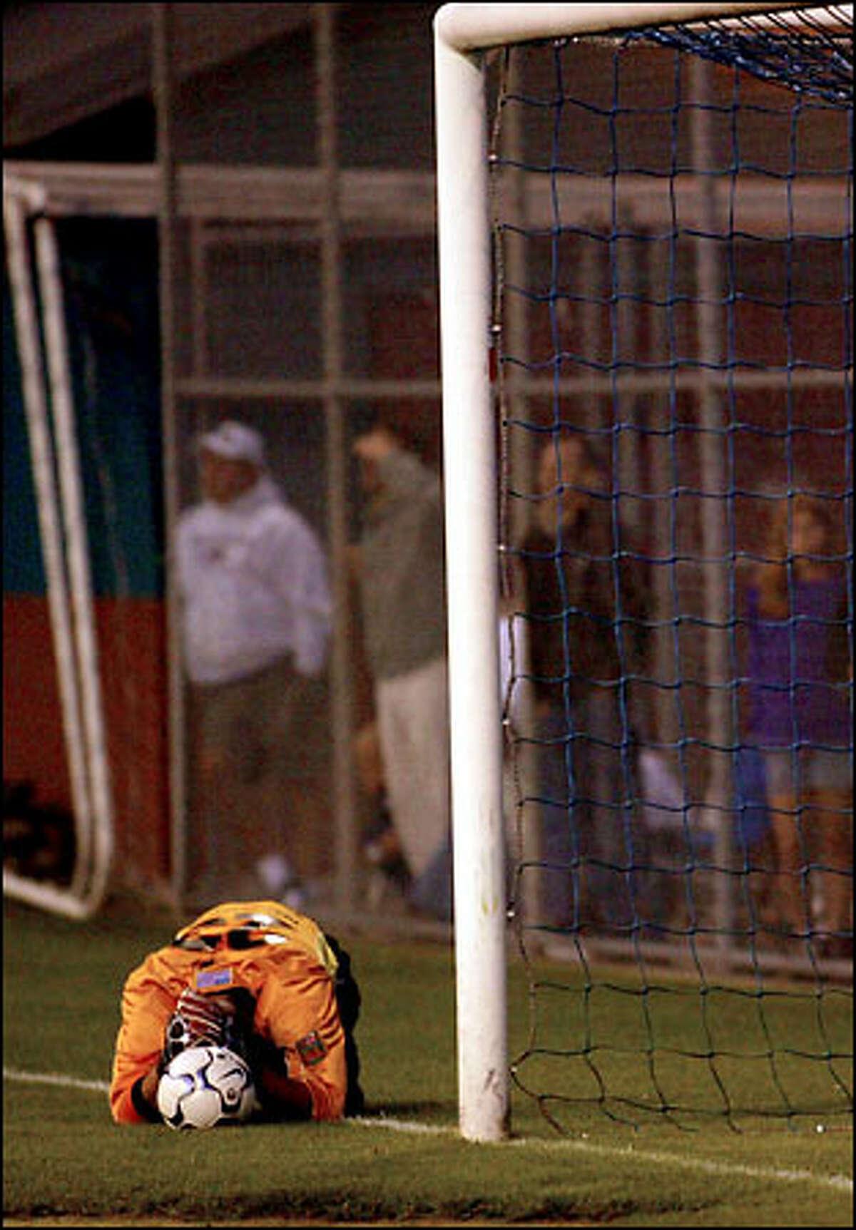 Sounders goalie Preston Burpo kneels dejectedly after allowing Ariel Graziani's winning goal.