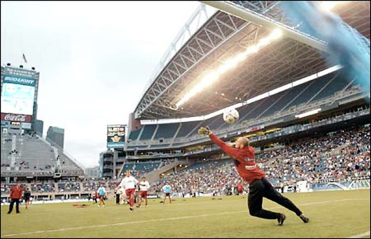 Sounders goalie Preston Burbo practices before the start of the first soccer game at Seahawks Stadium. The Sounders scored their first goal in the 23rd minute en route to a 4-1 victory over the Vancouver Whitecaps.