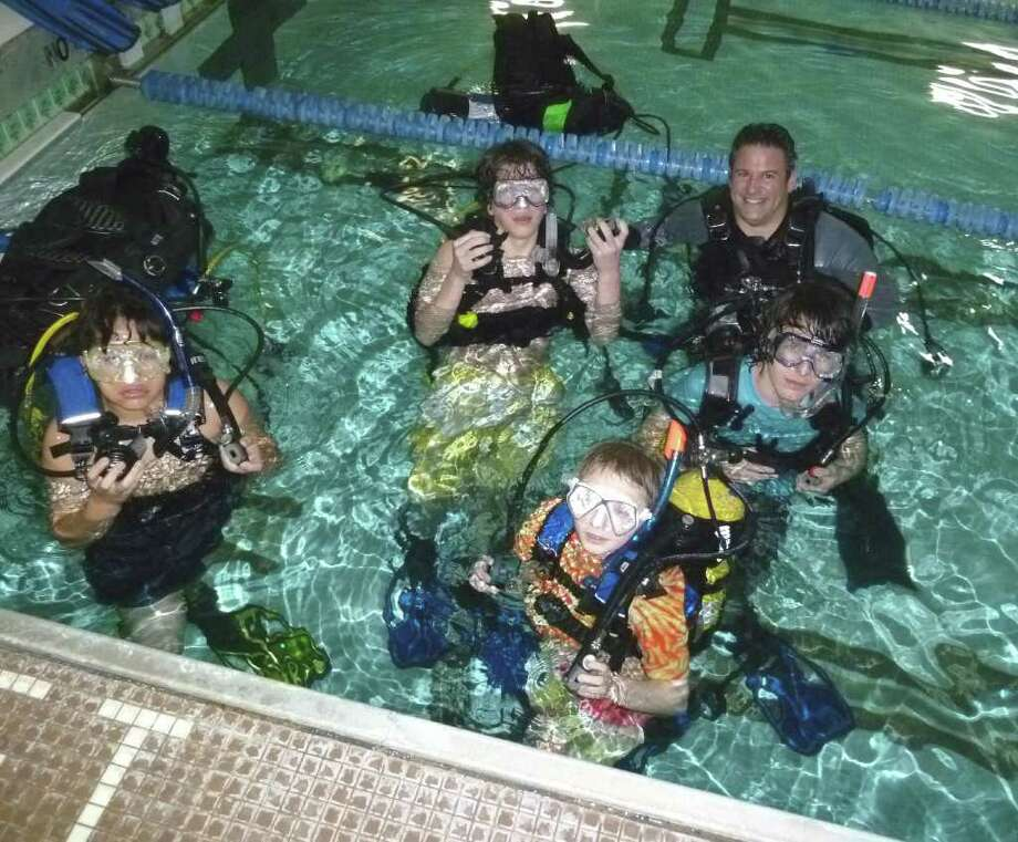 Rex Dive Center instructor Dan Debartolo with Westport Boy Scouts at the Westport Weston Family Y on Friday night. Photo: Contributed Photo, Contributed Photo/Mike Lauterborn / Westport News contributed