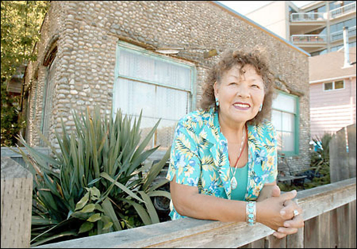 Carmen Munoz, 71, helped to collect the rocks her grandmother and mother used to surface the West Seattle beach house. The house was built in 1928.