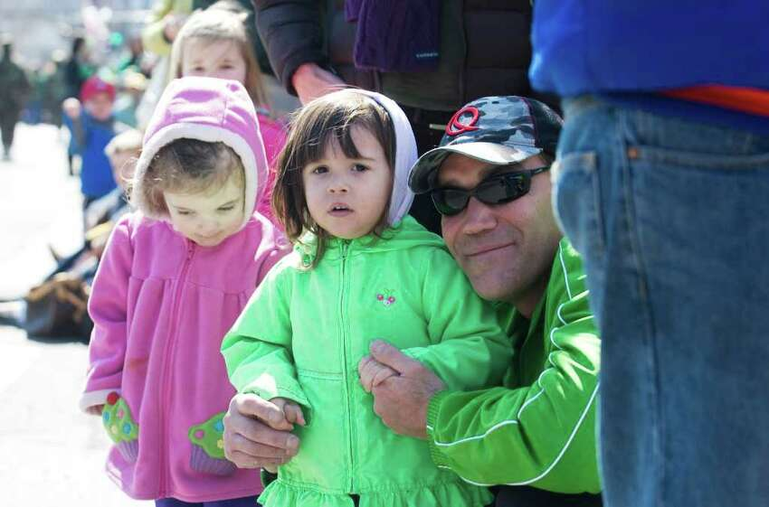 Julianna Kovacs, 2, and her father John Kovacs enjoy the Stamford St. Patrick's Day parade in Stamford, Conn. on Saturday March 12, 2011.
