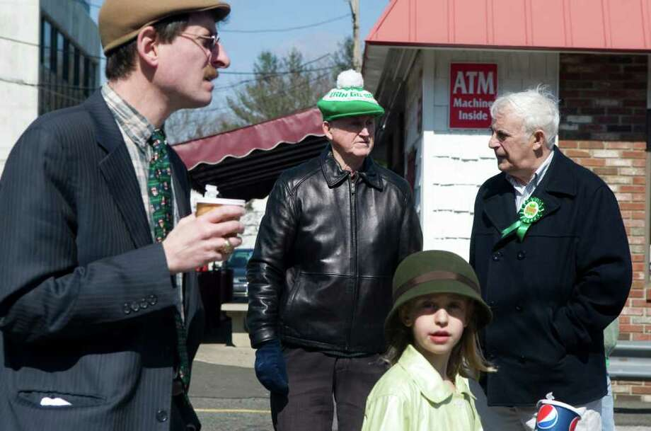 Marchers prepare at the start of Stamford's Anuual St. Patrick's Day parade in Stamford, Conn. on Saturday March 12, 2011. Photo: Kathleen O'Rourke, Stamford Advocate / Stamford Advocate