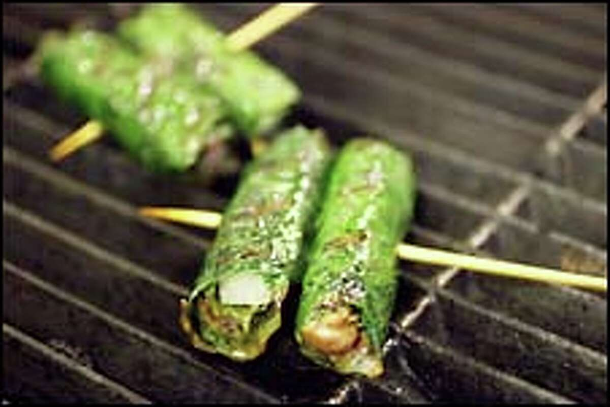Juices flow from the wrapped Bo La Lot Beef as they cook on the grill. The leaf bestows a mysterious, spicy fragrance to the meat.