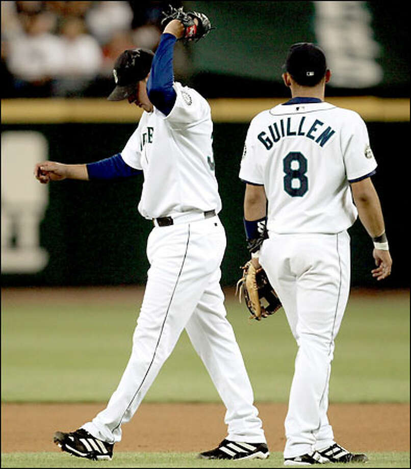 Freddy Garcia shows his disgust after failing to snag Mike Sweeney's two-out liner in the fifth. Raul Ibanez then lashed a two-run double. Photo: Paul Kitagaki Jr./Seattle Post-Intelligencer