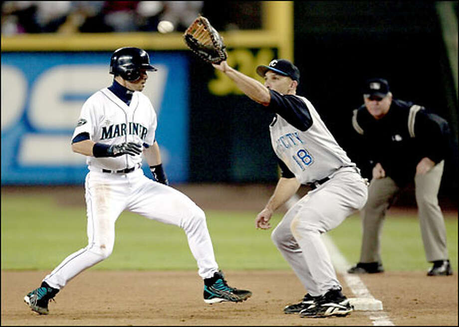 Ichiro hastens back to the bag to beat Paul Byrd's pickoff throw to first baseman Raul Ibanez. Ibanez hit two doubles to drive in four Kansas City runs. Photo: Paul Kitagaki Jr./Seattle Post-Intelligencer