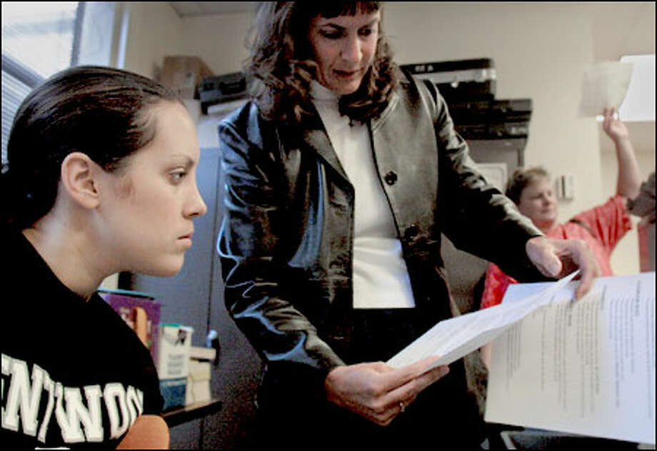 First-year math teacher Julia Johnson, left, works on guidelines with fellow teacher Barb Genger, center, in as they plan for the school year at Kentwood High School. Johnson, who received her undergraduate degree in mechanical engineering, will be teaching algebra I and algebra II classes. Photo: Melina Mara/Seattle Post-Intelligencer