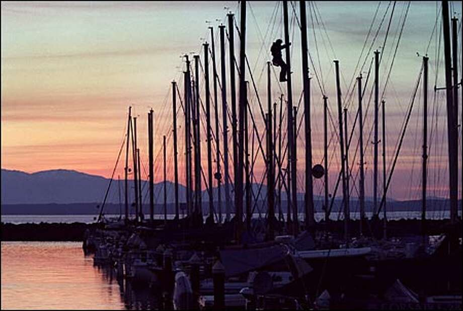 The warm days of summer sailing are nearing an end for Puget Sound mariners. But slightly higher ocean temperatures in the tropics could portend mild weather this fall and winter, according to forecasters. Photo: Renee C. Byer/Seattle Post-Intelligencer