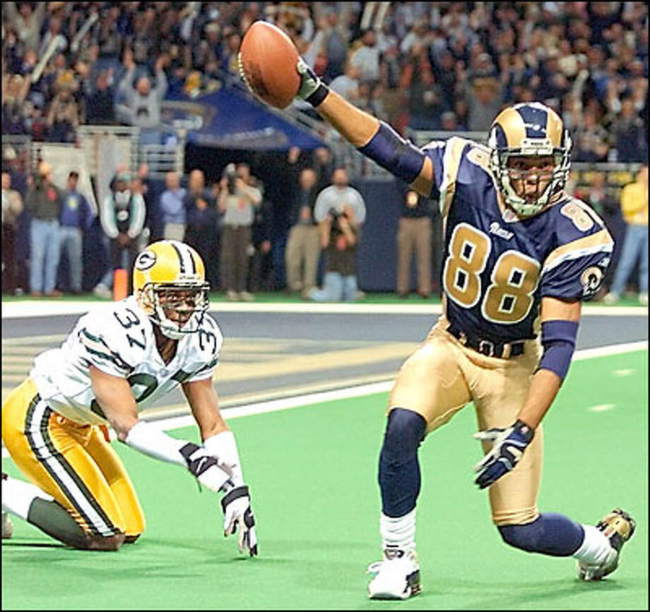 Receiver Torry Holt, in his fourth season with the St. Louis Rams, has 215 catches for 3,786 yards and 19 touchdowns. Photo: / Associated Press