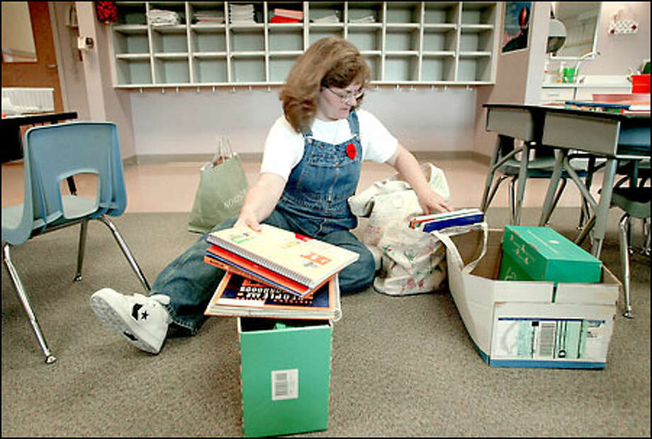 First-grade teacher Debra Culbertson sorts lesson plans to take home as she and other teachers at Central Primary Center prepare to strike. Photo: Meryl Schenker/Seattle Post-Intelligencer