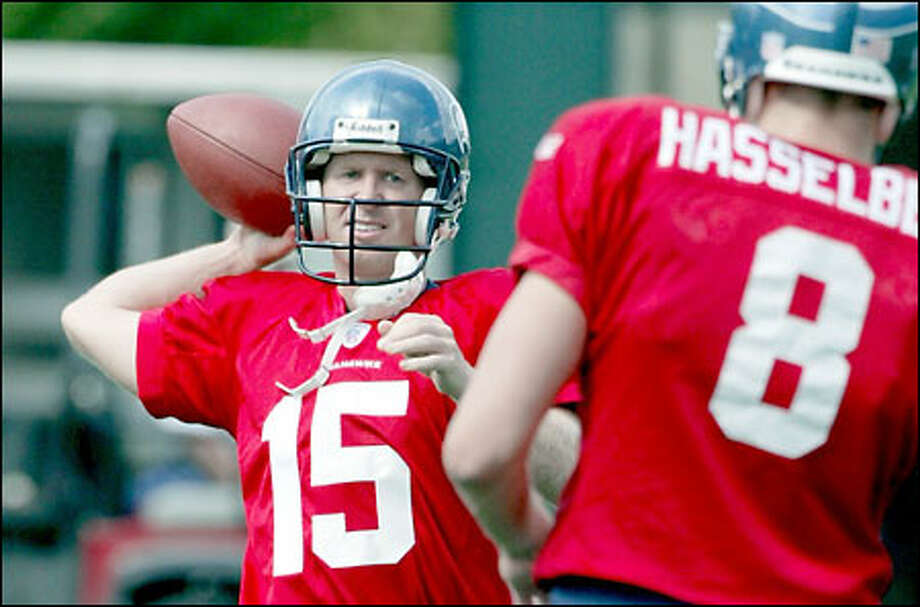 Dave Dickenson warms up with fellow quarterback Matt Hasselbeck in Kirkland during Dickenson's first practice with the Seahawks since he was picked up on waivers Monday from the San Diego Chargers. Photo: / Associated Press