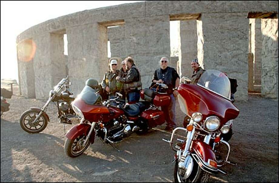 Members of the Outsiders Motorcycle Club from Tacoma stop at Maryhill's Stonehenge on their annual summer's-end journey through the West. A full-scale replica of England's Neolithic monument, this Stonehenge is a memorial to Klickitat County's war dead. Photo: Jeff Larsen/Seattle Post-Intelligencer