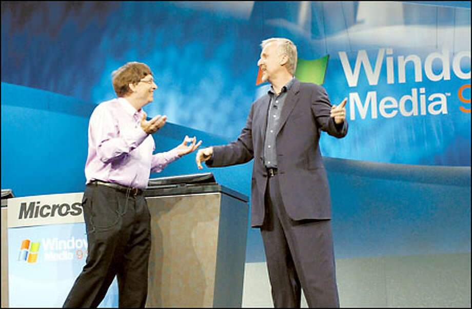 Microsoft Chairman Bill Gates, left, greets film director James Cameron on stage before an address yesterday about the Windows Media 9 software. Photo: / Associated Press