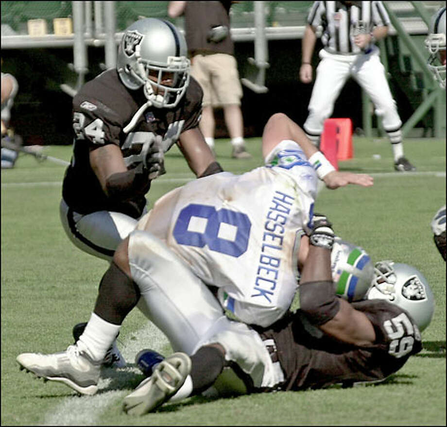 Seahawks quarterback Matt Hasselbeck is sacked by the Raiders' William Thomas in last year's game in Oakland. Hasselbeck was sacked six times by the Raiders and left the game after aggravating a pulled groin. Photo: Associated Press