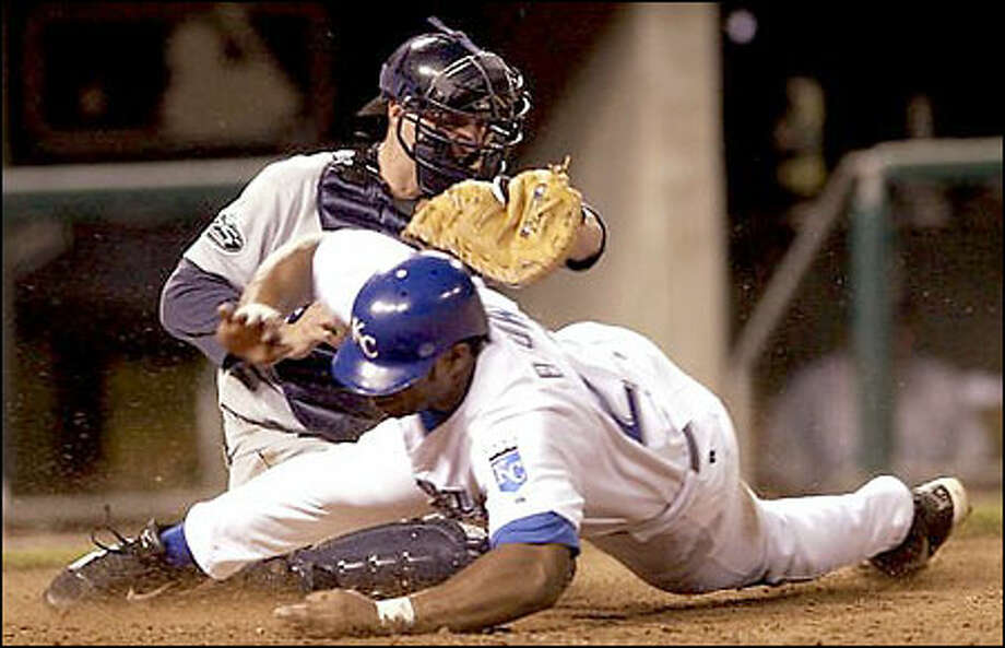 Mariners catcher Dan Wilson tags out the Royals' Dee Brown in the sixth inning. Brown, trying to score from second base on Angel Berroa's single, was thrown out by Mike Cameron. Photo: Associated Press