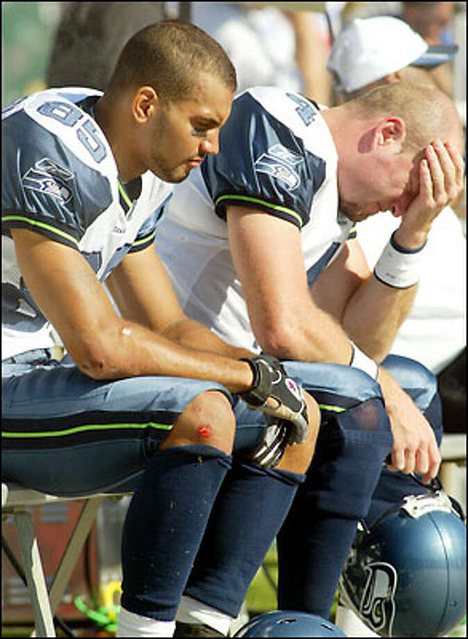 Seahawks wide receiver Alex Bannister and quarterback Trent Dilfer can't bear to watch. Photo: / Associated Press