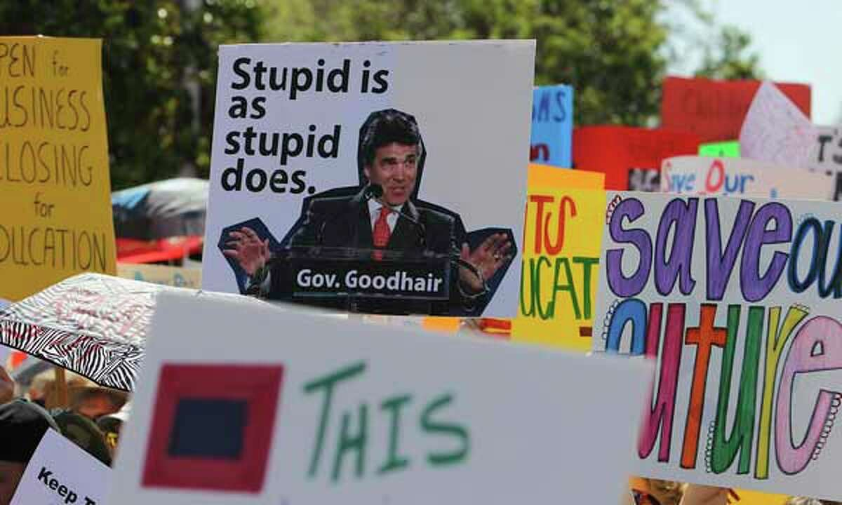 Many of the signs were aimed at Texas governor Rick Perry for his recent comments about the loss of teachers in schools. Thousands of educators and supporters rally at the Texas Capitol to decry looming budget cuts and elimination of jobs for educators on Saturday, Mar. 12, 2011. Kin Man Hui/kmhui@express-news.net