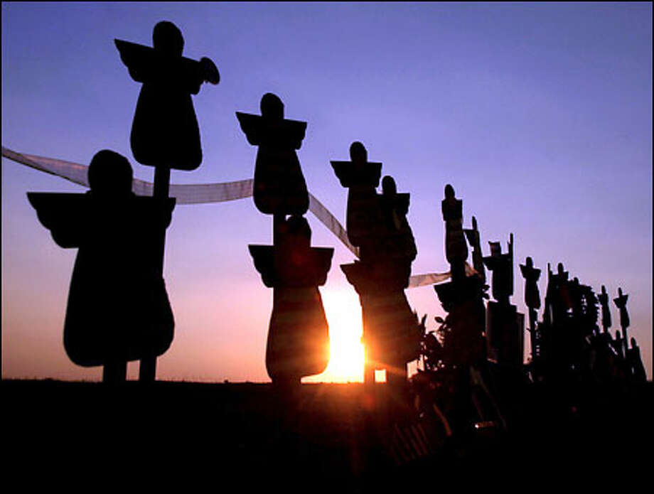 """An """"Angels of Freedom"""" memorial honors Flight 93 victims at the crash site near Shanksville, Pa. President Bush will lay a wreath there today. Photo: / Associated Press"""