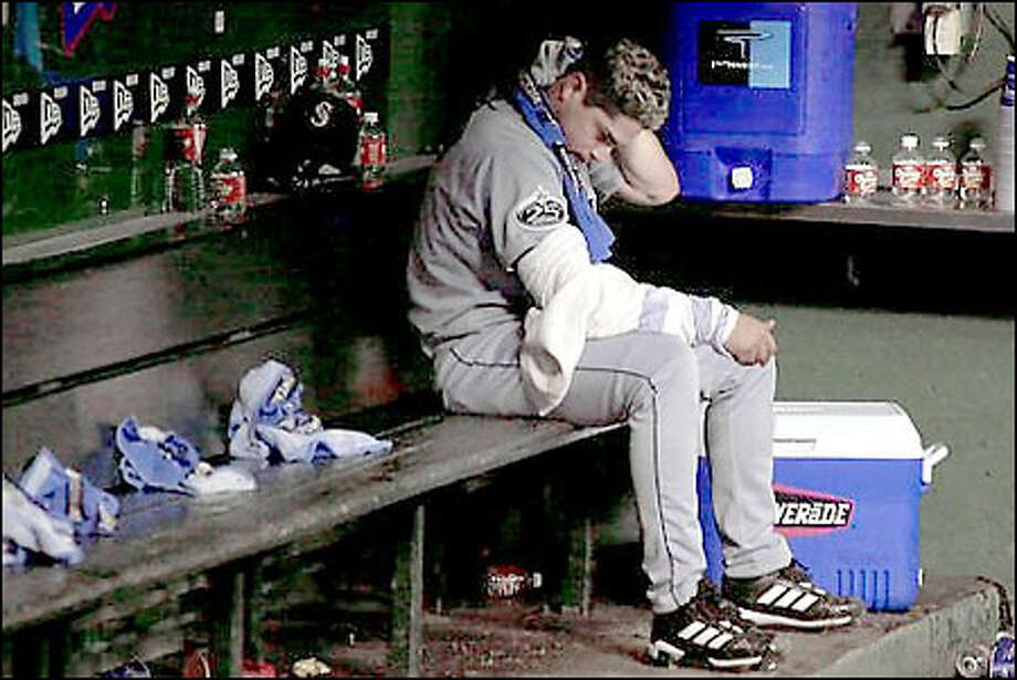 Mariners starting pitcher Joel Pineiro sits in the dugout after the 3-2 loss to the Rangers. Photo: / Associated Press