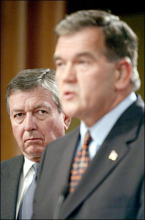 John Ashcroft, left, looks on as Tom Ridge announces the increased terror alert warning yesterday. Photo: / Associated Press