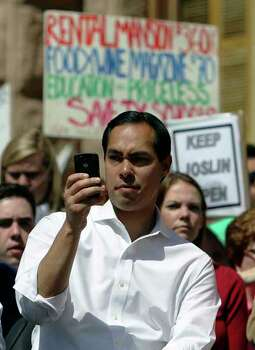 San Antonio mayor Julian Castro takes a picture of the thousands of educators and supporters at a rally at the Texas Capitol to decry looming budget cuts and elimination of jobs for educators on Saturday, Mar. 12, 2011. Castro later addressed the crowd. Kin Man Hui/kmhui@express-news.net
