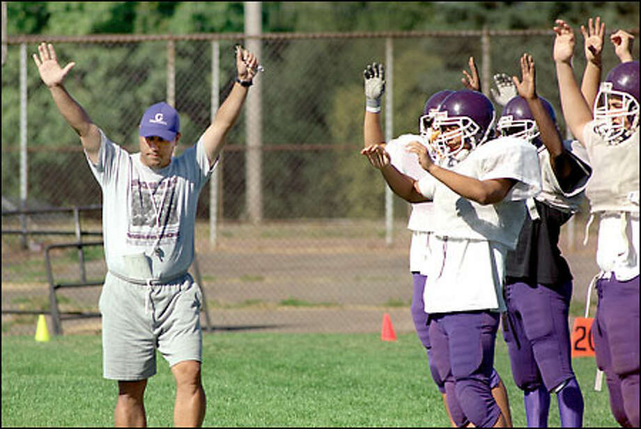 It's not a plea for touchdowns, but it might as well be: New coach Scott Laigo inherits a Garfield team that has struggled in recent seasons. The Bulldogs were 2-7 last year under Luther Carr. Photo: Scott Eklund/Special To The Seattle Post-Intelligencer