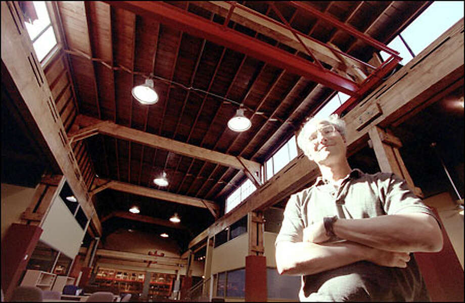 Henry Liebman stands inside Office Furniture Solutions, one of the warehouses renovated by the Golden Rainbow Freedom Fund. Photo: Loren Callahan/Seattle Post-Intelligencer