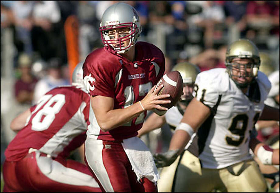 Cougars quarterback Jason Gesser, turning to hand the ball off against Idaho last Saturday, will have to go to the air early and often Saturday in Columbus against No. 6 Ohio State. Photo: / Associated Press
