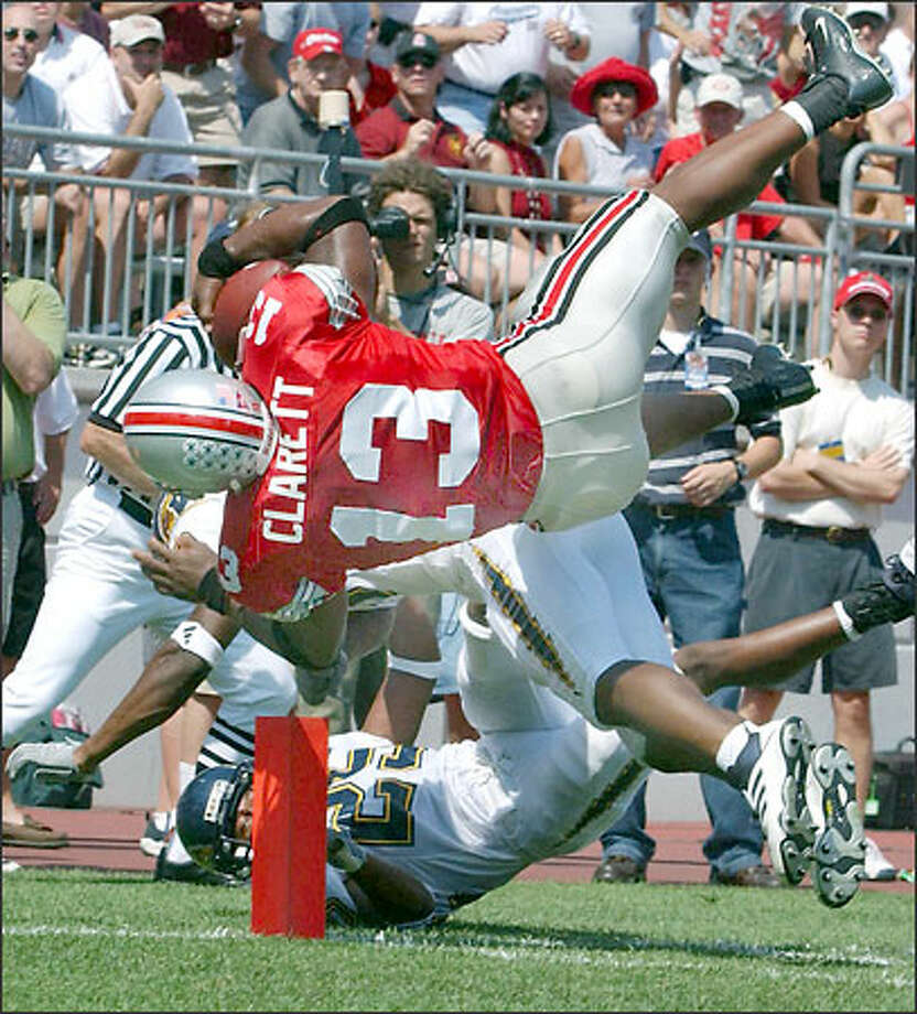Ohio State tailback Maurice Clarett dives into the end zone for one of his two touchdowns against Kent State last Saturday. The 5-foot-9, 230-pounder gained 175 yards and scored three times against Texas Tech the week before. Photo: / Associated Press