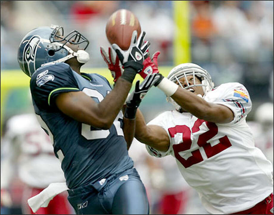 Seahawks wide reciever Darrell Jackson beats Cardinals cornerback Duane Starks for a 48-yard pass reception. Four plays later, Rian Lindell kicked a 46-yard field goal for a 3-0 lead. Photo: Paul Kitagaki Jr./Seattle Post-Intelligencer