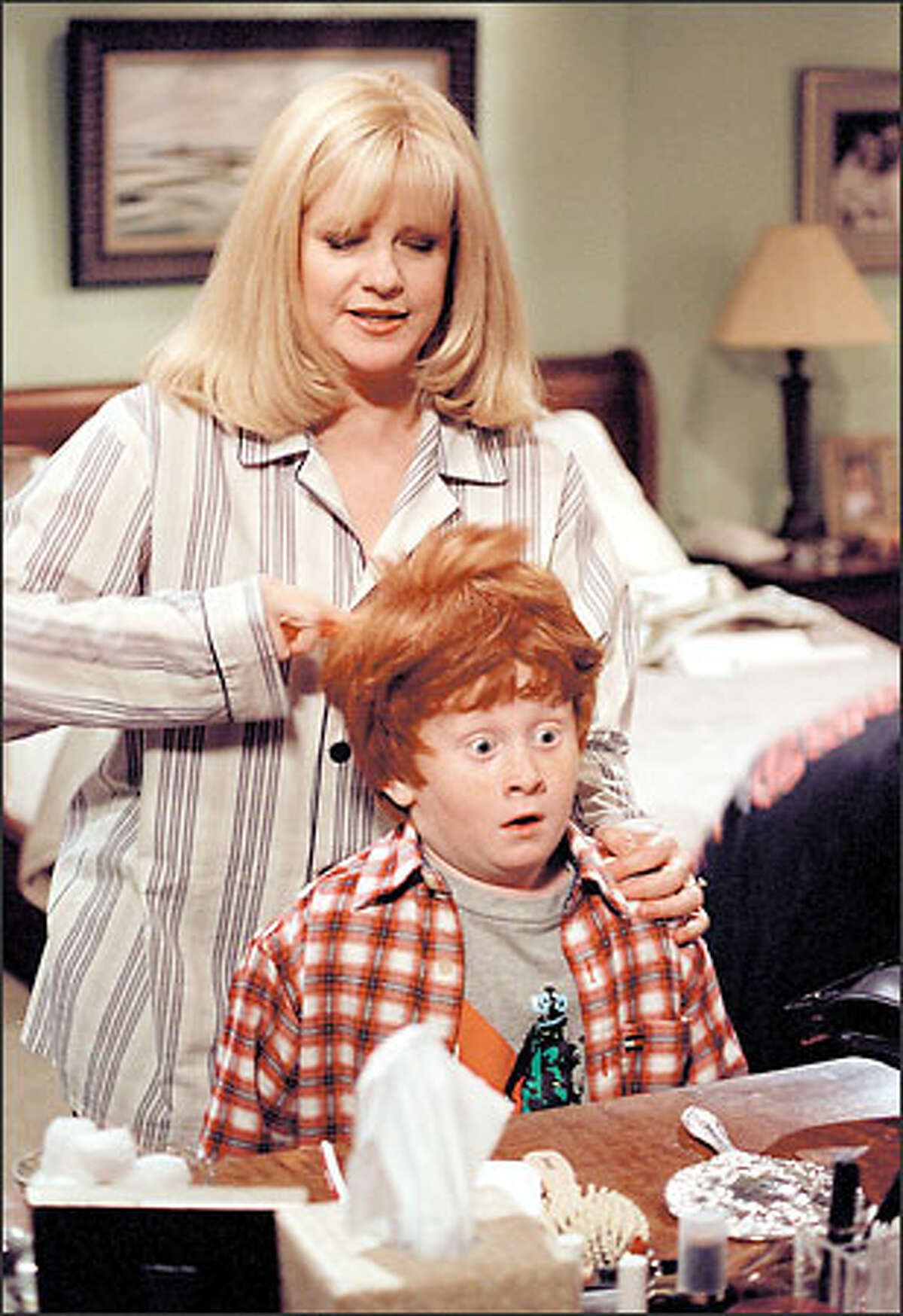 """In """"Life With Bonnie,"""" Bonnie Molloy (Bonnie Hunt), shown with son Charlie (Charlie Stewart) is a woman who juggles the roles of wife, mother and host of the local morning talk show, """"Morning Chicago."""" In the series, Hunt's improvisational skills shine during unscripted interviews with real-life guests (non-actors) of the talk show."""