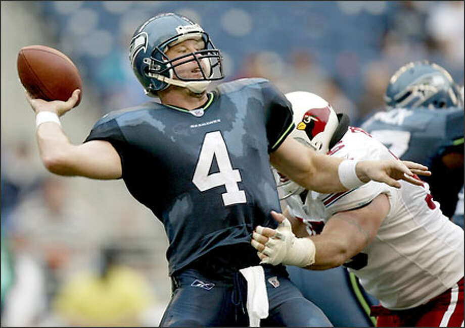 Seahawks quarterback Trent Dilfer is pressured by Cardinals defensive end Thomas Burke on Seattle's last drive Sunday. Photo: Paul Kitagaki Jr./Seattle Post-Intelligencer