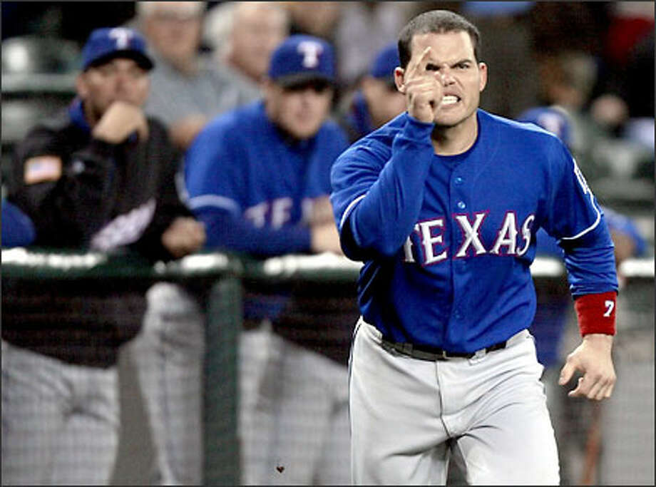 Rangers catcher Ivan Rodriguez gestures angrily at home plate umpire Mark Carlson after getting thumbed from the game in the second inning for arguing on a strikeout. Photo: Paul Kitagaki Jr./Seattle Post-Intelligencer