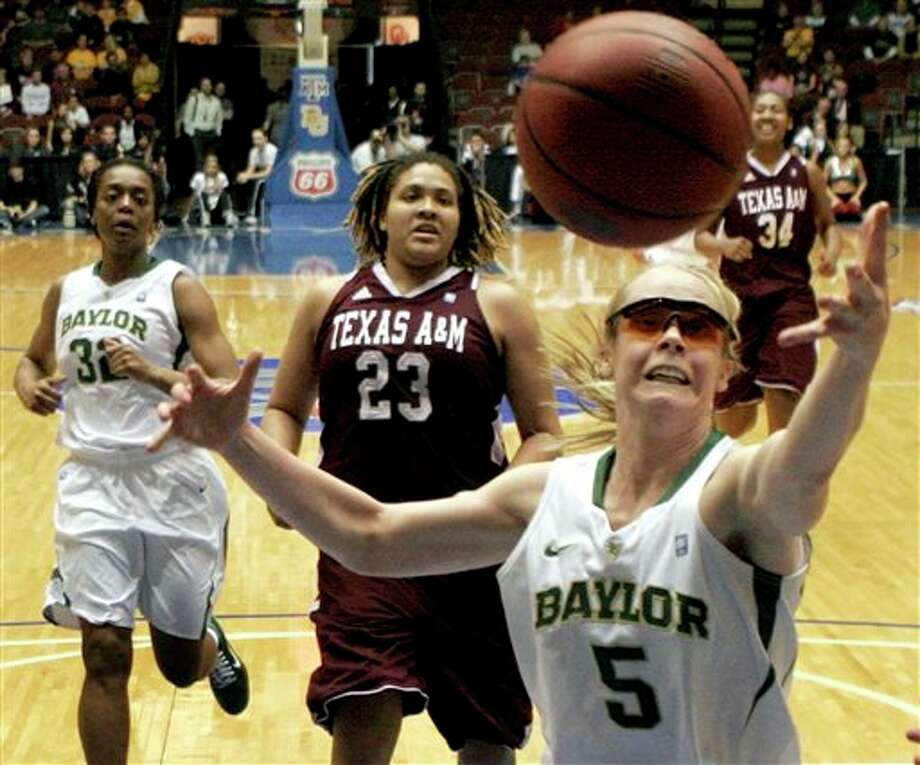 Baylor's Melissa Jones (5) reaches for a rebound as Texas A&M's Danielle Adams (23) and Baylor's Brooklyn Pope look on Saturday. (Jeff Roberson/Associated Press)