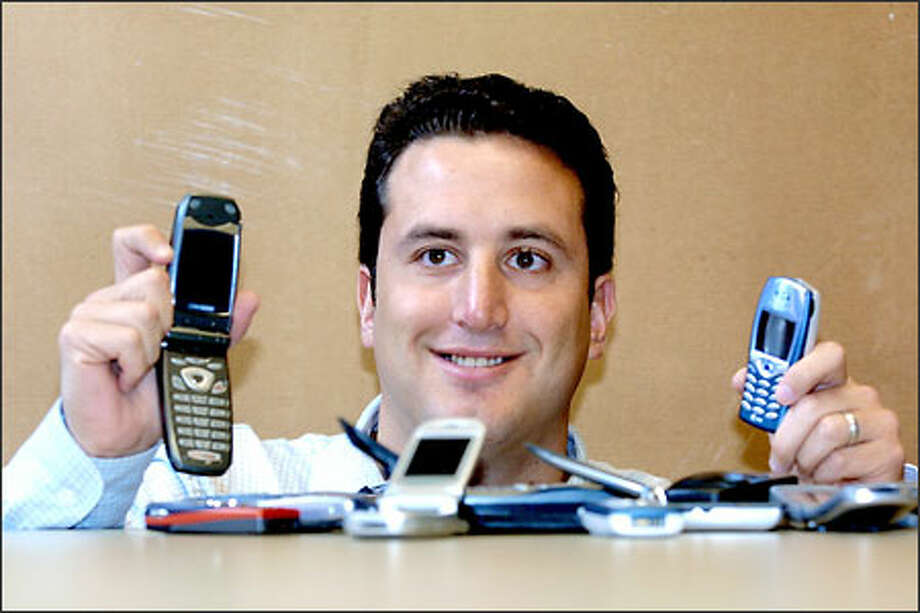 Brian Levin, founder and CEO of Mobliss Seattle, compiled sports information services and game content, such as The Price is Right and Family Feud games, for distribution on cellular phones. He's been encouraged by recent developments. Photo: Phil H. Webber/Seattle Post-Intelligencer