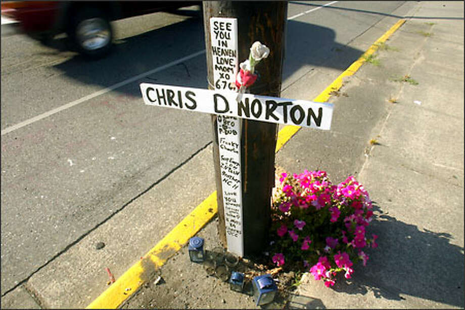 A memorial to Chris D. Norton continues to grace the telephone pole in the 5900 block of Grove Street in Marysville where he was killed on June 7, 2001. Photo: Grant M. Haller/Seattle Post-Intelligencer