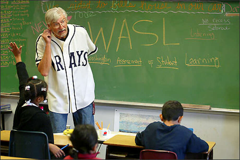 Fourth-grade teacher David Wilhelm explains to his class at Whitworth Elementary School that the WASL exam they will take this year involves listening skills. Photo: Meryl Schenker/Seattle Post-Intelligencer