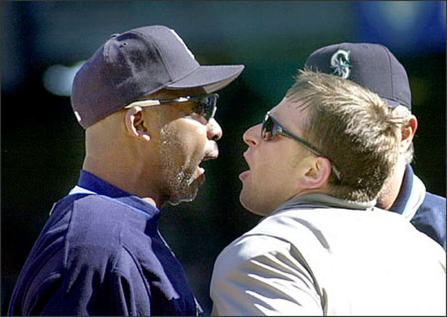 Mariners hitting coach Gerald Perry has words with home-plate umpire Mike Everitt after a called strike three on Mike Cameron against Anaheim on Saturday. Photo: / Associated Press