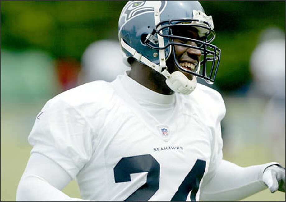 The Seahawks need a healthy Shawn Springs in the lineup Sunday to battle Randy Moss. Photo: Gilbert W. Arias/Seattle Post-Intelligencer