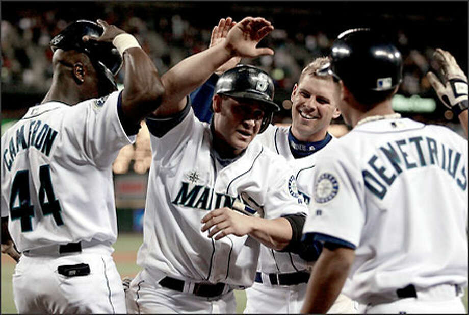 Bret Boone receives a hero's welcome after scoring the go-ahead run on Scott Podsednik's two-out double in the eighth inning. Boone raced home despite having a bruised right heel. Photo: PAUL KITAGAKI JR./P-I