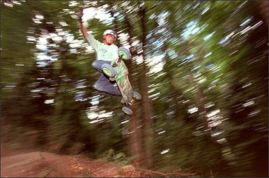 Leon Robbins catches air off a jump at St. Edward State Park. Photo: Loren Callahan/Seattle Post-Intelligencer