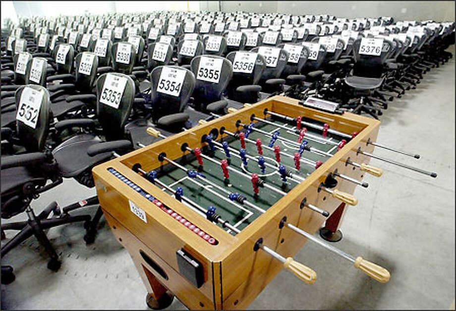 Thousands of items -- from a foosball table to office chairs to stress balls -- were auctioned yesterday and today in Houston to raise proceeds for Enron creditors. The Radisson Astrodome was packed with more than 1,000 bidders Photo: / Associated Press