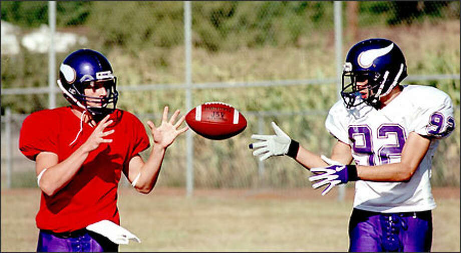 Quarterback Rob Iverson, left, and wide receiver Cody Ellis have been friends and playmates since childhood. Now the Puyallup High School seniors are down to their final seven regular-season football games, beginning tomorrow night against top-ranked Bethel. Photo: Scott Eklund/Seattle Post-Intelligencer