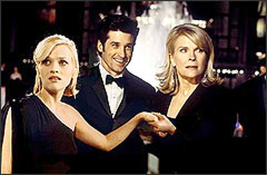 Reese Witherspoon, left, shines as a country girl engaged to a glamorous New York charmer (Patrick Dempsey) while winning approval from his mother, the mayor (Candice Bergen). The only hitch in this grand scheme is that Witherspoon's character is still hitched to the sweet boy back home in Alabama. Photo: PETER IOVINO