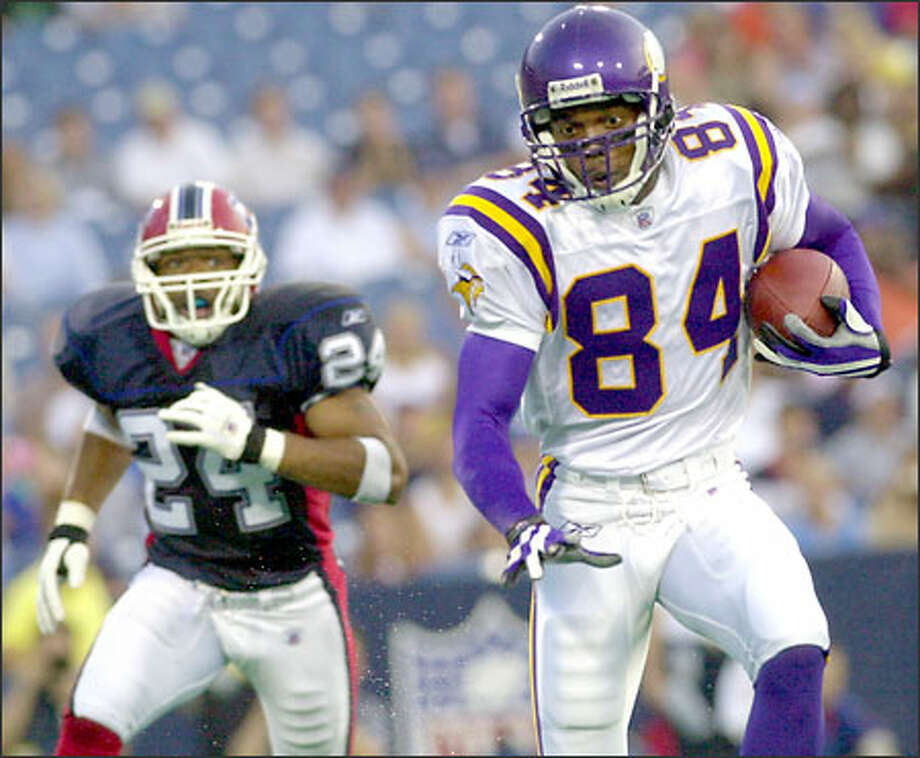 Randy Moss, taking off after one of his 11 receptions against Buffalo, has caught 21 passes for 185 yards and two touchdowns this season. Photo: / Associated Press