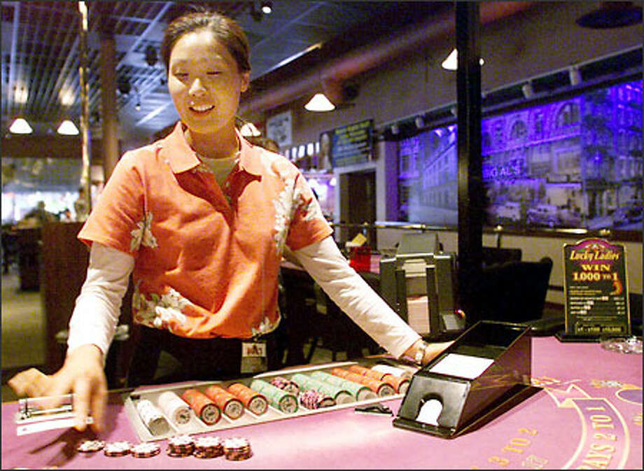 Miyong Yi deals a hand of blackjack at Big Al's Casino in Everett, just sold to Great Canadian Gaming Corp. Photo: Anthony P. Bolante/Seattle Post-Intelligencer