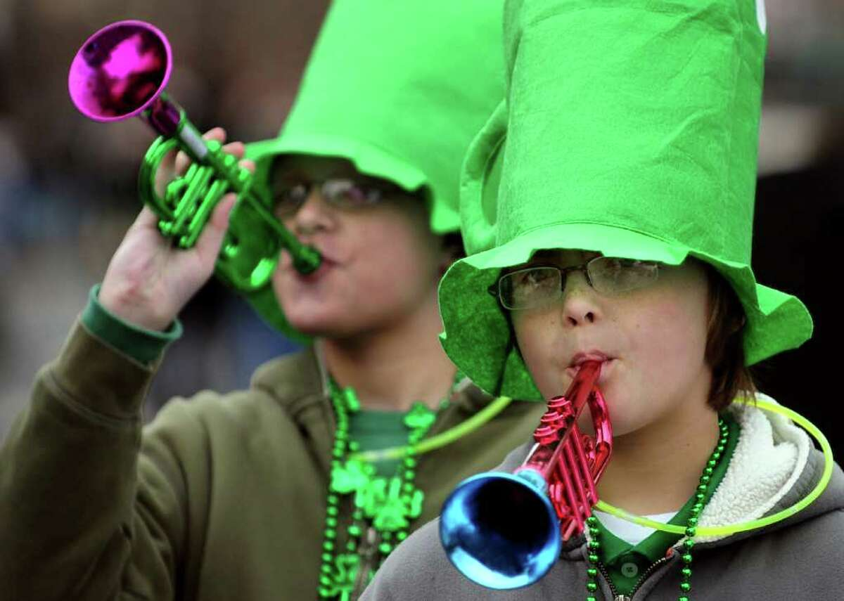 Twins Matthew, left, and Jared Giordano, both 11, of East Greenbush get in the spirit during the annual St. Patrick's Parade on Saturday, March 12, 2011, in Albany, N.Y. (Cindy Schultz / Times Union)