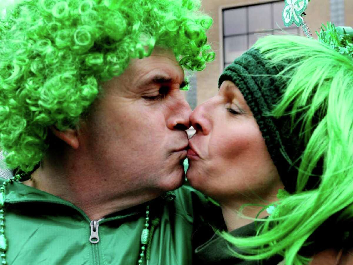 Bryan Leahey of Rensselaer, left, and Linda VanBergen of Sand Lake share an Irish kiss during the annual St. Patrick's Parade on Saturday, March 12, 2011, in Albany, N.Y. (Cindy Schultz / Times Union)