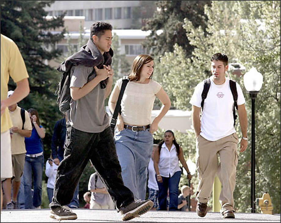 Students walk to class at Washington State University in Pullman last week. The school recently reported a surge in research income. Photo: Jeff T. Green/for The Seattle Post-Intelligencer
